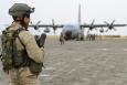 A Belgian soldier keeps an eye on a Belgian C-130 plane in Kunduz airport, Afghanistan, Tuesday 02 June 2009. Belgium will begin to bring its soldiers home from Afghanistan in 2021. (BELGA PHOTO BENOIT DOPPAGNE)