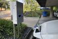 A electric car connected at a recharging point (BELGA PHOTO KATLEEN VASTIAU)