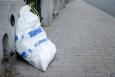 A white rubbish bag seen on a street in Brussels, Belgium. (BELGA PHOTO JONAS HAMERS)