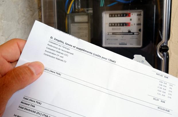 Illustration shows energy bills and an electricity meter. (BELGA PHOTO ERIC LALMAND)