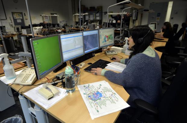 An emergency services phone operator at work (BELGA)
